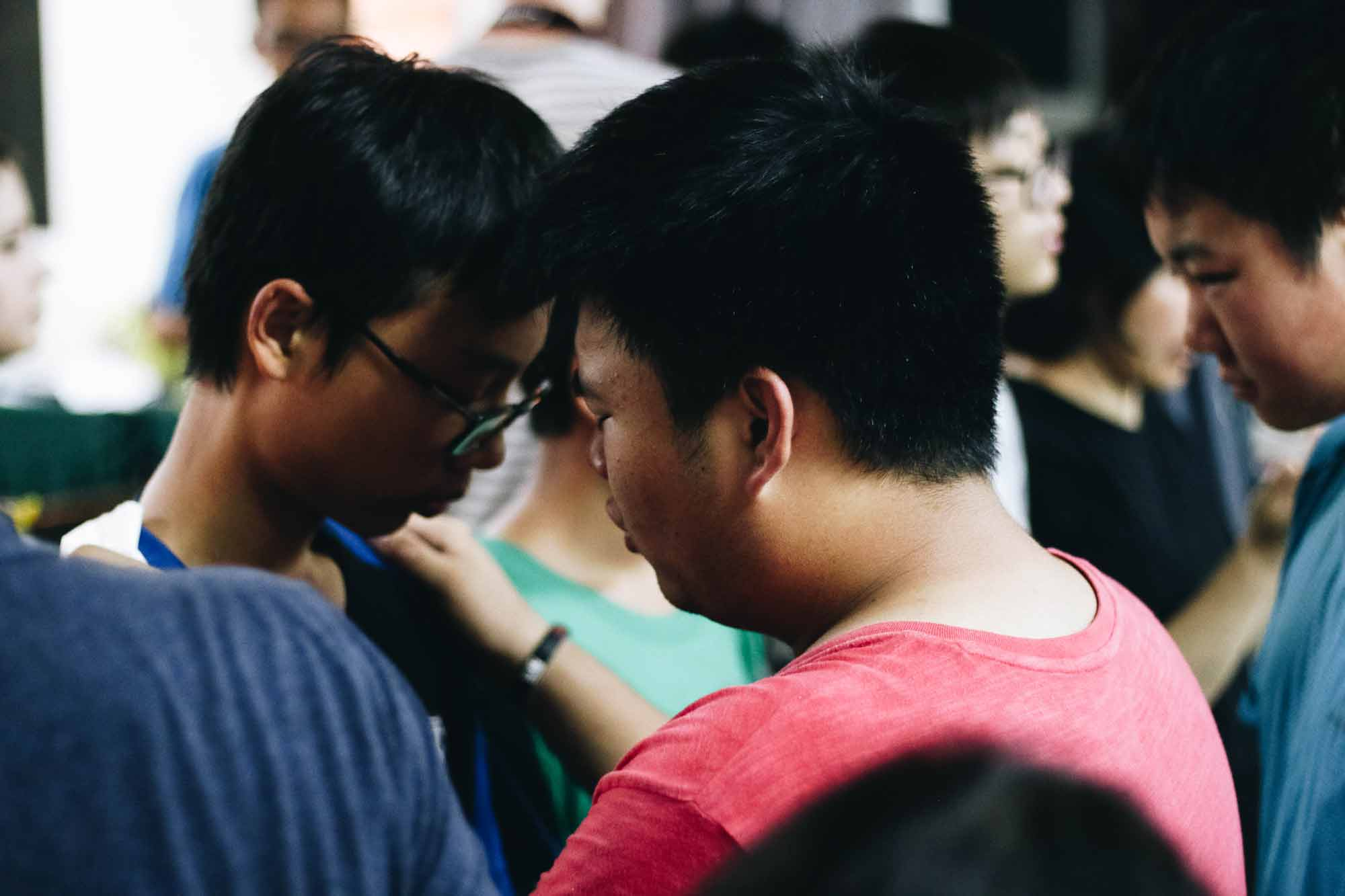 Arthur praying for other kids at the China Missions Summer Camp.